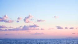 Beautiful coastal landscape pink sunrise on the endless ocean with the colors of the year 2016 rose quartz and serenity