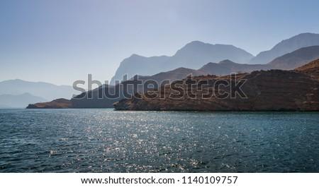 Beautiful coastal scenery near Khasab, in Musandam peninsula, Oman, photo taken from a boat during a tour