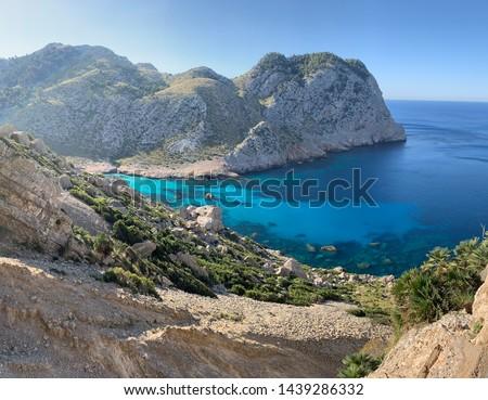 Beautiful coastline view of the mountain cliff with turquoise water beaches ant the wild nature. Cala Figuera, Serra de Tramuntana, Cap de Formentor, Mallorca, Spain #1439286332