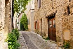 Beautiful cobblestone lane in a village in Provence, France