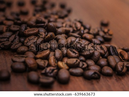 Beautiful coffee beans, Fried coffee beans on a chocolate board.