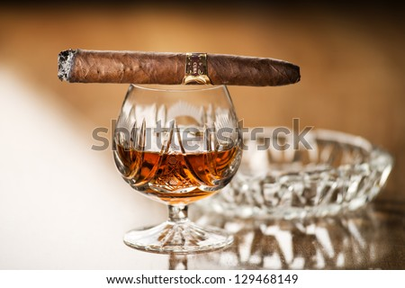 Beautiful cognac with cuban cigar close up shoot