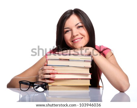 Beautiful college girl sitting near the glasses and holding books