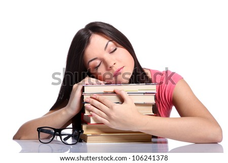 Beautiful college girl sleeping and holding books
