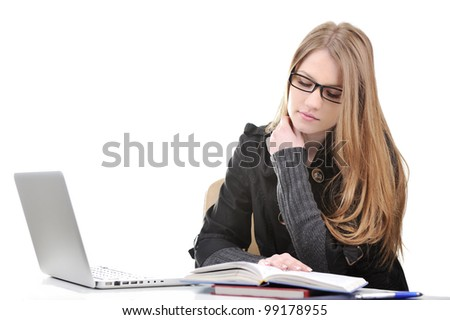 Beautiful college girl with laptop and books