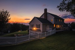 Beautiful colonial style house at sunset