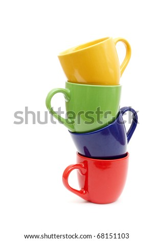 Beautiful color cups on a white background - stock photo