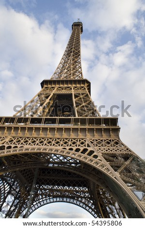 Beautiful Color Image of the Eiffel Tower with Cloudy Blue Sky.