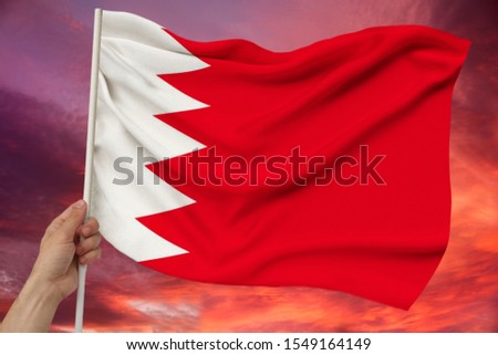 beautiful colored national flag of Bahrain state on the texture of the fabric, silk with waves, closeup #1549164149