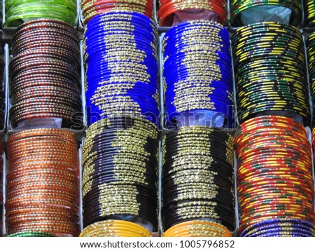 Beautiful colorful Bangles blue red yellow and many, Hands wearing Jewellery, Indian tradition girls and women wears color bangles #1005796852