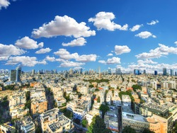 Beautiful colorful HDR image of the skyline of Tel Aviv with its famous skyscrapers on blue cloudy sky