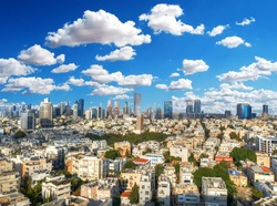 Beautiful colorful HDR image of the skyline of Tel Aviv with its famous skyscrapers on blue cloudy sky - aerial image