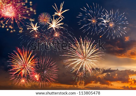 Beautiful colorful holiday fireworks in the evening sky with majestic clouds,  long exposure #113805478