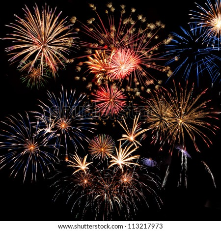 Beautiful colorful holiday fireworks on the black sky background,  long exposure - stock photo