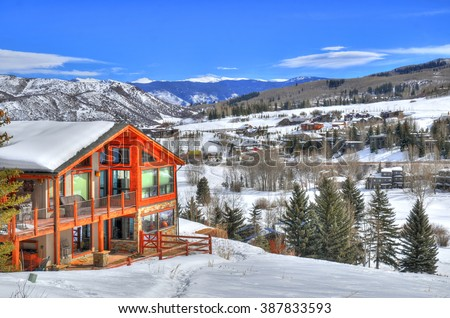 Beautiful colorful landscape in Snowmass - a ski resort with a background of a small residential area (small huts) surrounded by trees (HDR image) in Aspen Colorado