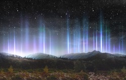 Beautiful colorful light pillars at night over the mountains