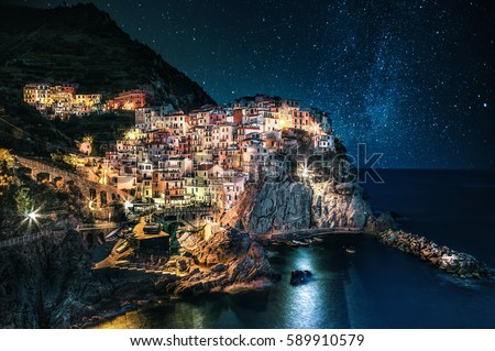 Beautiful colorful nightscape with Manarola village in the Cinque Terre (Liguria, Italy) Travel Italia