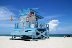 Beautiful colorful scene of a fancy lifeguard hut on North Miami Beach on a sunny day