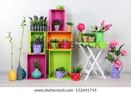 Beautiful colorful shelves with decorative elements standing in room #132641714