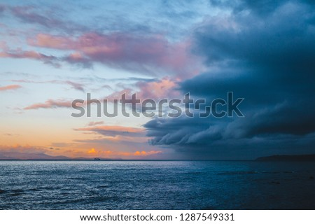 Beautiful colorful sky with approaching storm #1287549331