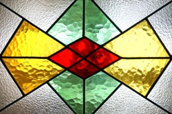 Beautiful colorful stained glass window detail and texture in Al Faruq Mosque, sangatta, East Kalimantan, Indonesia.