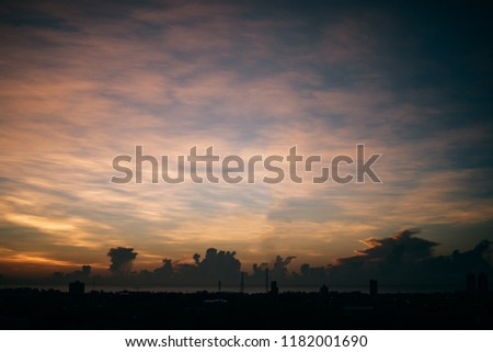 Beautiful colorful sunrise at the sea with dramatic clouds and sun shining #1182001690