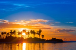 Beautiful colorful sunset at tropical island on Maldives in Indian Ocean