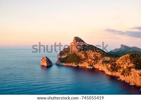 Beautiful, colorful sunset. Beautiful view of the sea and mountains. Evening landscape. Majorca.Balearic Islands.Spain.Aerial view.Beautiful views of the rocks and the sea from the top of the mountain