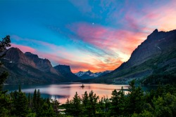 Beautiful colorful sunset over St. Mary Lake and wild goose island in Glacier national park