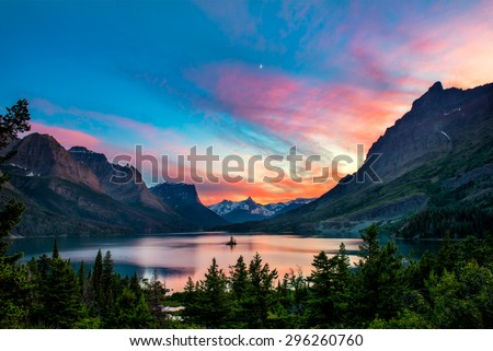 Beautiful colorful sunset over St. Mary Lake and wild goose island in Glacier national park #296260760