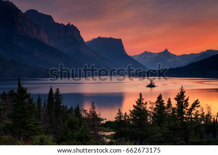 Shutterstock Beautiful colorful sunset over St. Mary Lake and wild goose island in Glacier national park, Montana, USA