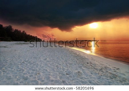 Beautiful colorful sunset over the ocean in the Maldives seen from the beach - HDR