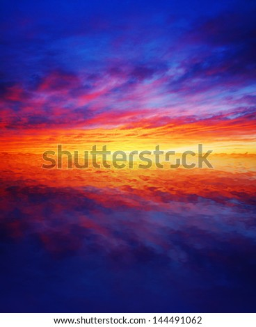 stock-photo-beautiful-colorful-sunset-reflected-over-water-144491062.jpg