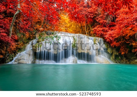 Beautiful colorful waterfall in autumn forest