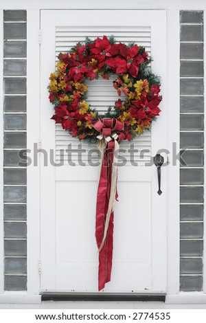 beautiful, colorful wreath on door