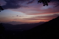 beautiful colourful Caribbean sunset overlooking the town of Ocoa, dominican republic