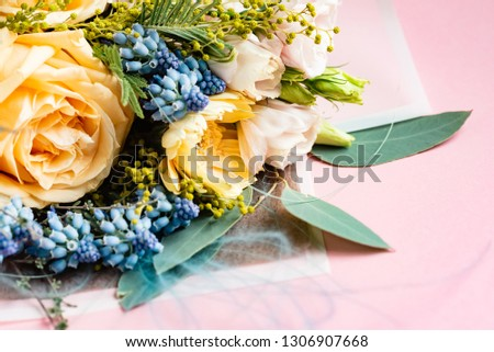 beautiful colourful flower bouquet on the pink background