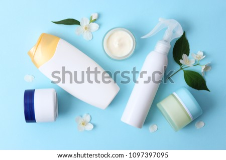 beautiful composition of a set of jars of cosmetics and flowers. top view, flatlay, insta #1097397095