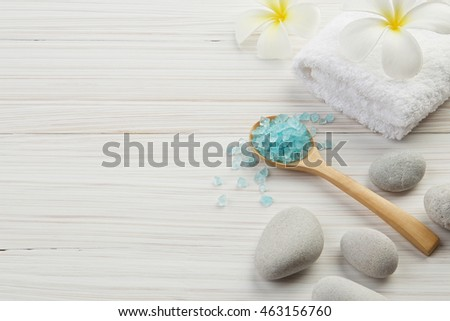 beautiful composition of spa treatment on wooden background. salt, spoon, stone, towel and flowers #463156760