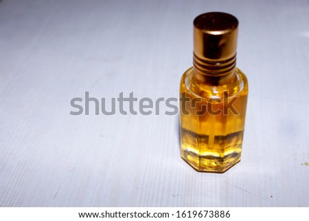 Beautiful composition with bottle of perfume, aromatic oil