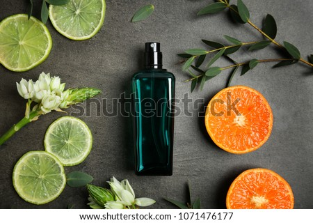 Beautiful composition with bottle of perfume on grey background, flat lay #1071476177