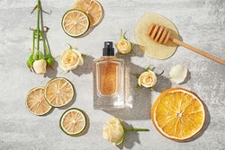 Beautiful composition with bottle of perfume on light background, flat lay