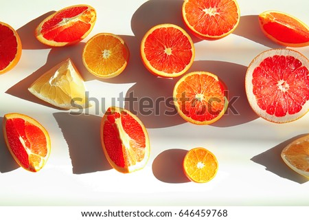 Beautiful composition with citrus fruits on white background - Shutterstock ID 646459768