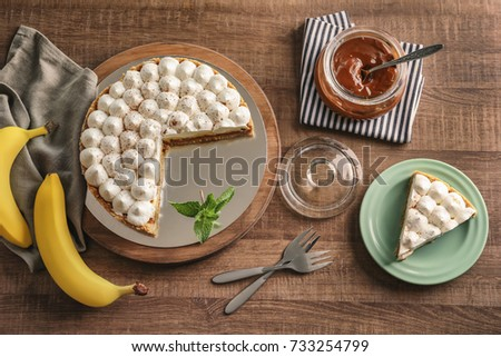 Beautiful composition with delicious banana cake on table #733254799
