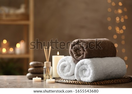 Beautiful composition with spa stones on grey marble table Stock photo ©