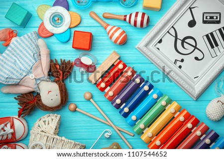 Beautiful composition with xylophone on wooden background. Baby songs concept #1107544652