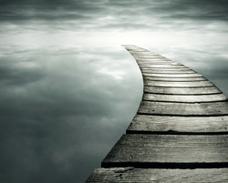Beautiful conceptual background with a wooden path in to the infinity dramatic sky