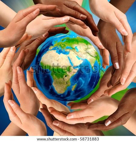 Beautiful conceptual symbol of the Earth globe with multiracial human hands around it. Unity and world peace concept. - stock photo