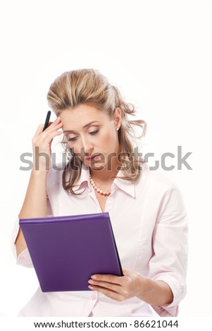 Beautiful concerned business woman reading important papers