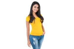 Beautiful confident Asian woman in plain yellow t-shirt and blue jeans posing with hand in pocket on white background
